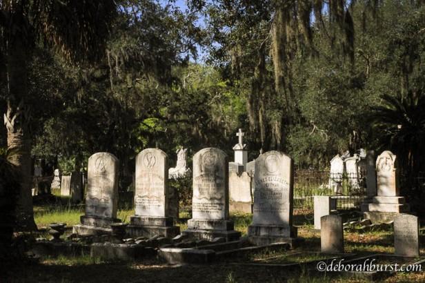 apal-cem-row-headstones-trees-wm