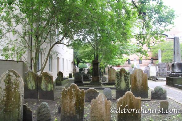 Circular graveyard stones wet oak wm.jpg